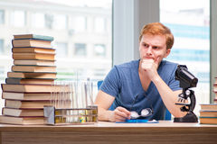 The young student tired and exhausted preparing for chemistry exam Stock Photos