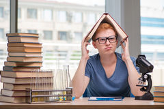 The young student tired and exhausted preparing for chemistry exam Royalty Free Stock Photography