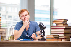 The young student tired and exhausted preparing for chemistry exam. Young student tired and exhausted preparing for chemistry exam Royalty Free Stock Images