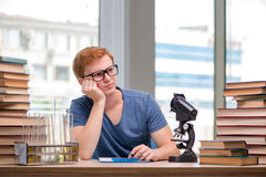 The young student tired and exhausted preparing for chemistry exam Royalty Free Stock Photos