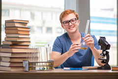 The young student tired and exhausted preparing for chemistry exam Royalty Free Stock Images