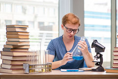 The young student tired and exhausted preparing for chemistry exam. Young student tired and exhausted preparing for chemistry exam Royalty Free Stock Photo