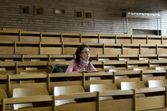 Young student at the university during exam. In the lecture hall Royalty Free Stock Images