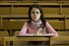 Young student at the university during exam. In the lecture hall Royalty Free Stock Photography