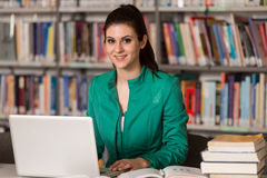 Young Student Using Her Laptop In A Library Royalty Free Stock Images
