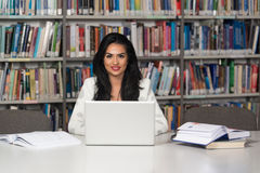 Young Student Using Her Laptop In A Library Stock Photo