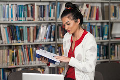 Young Student Using Her Laptop In A Library Royalty Free Stock Photo