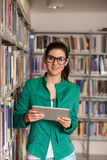 Young Student Using Her Laptop In A Library Stock Image