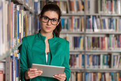 Young Student Using Her Laptop In A Library Stock Photography