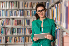 Young Student Using Her Laptop In A Library Royalty Free Stock Photos