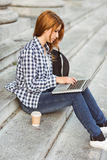 Young student using her laptop to study outside Stock Images