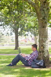 Young student using his laptop outside. On college campus Stock Photo