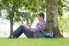 Young student using his laptop to study outside. On college campus Stock Photo