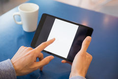 Young student using his tablet in cafe Royalty Free Stock Photo
