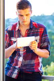 young student using tablet outdoor at sunny day Royalty Free Stock Photo
