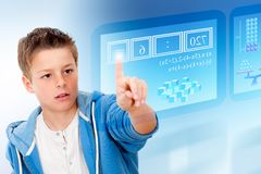 Young student with virtual futuristic interface. Royalty Free Stock Photos
