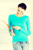 Young student woman with her notes. Royalty Free Stock Photography