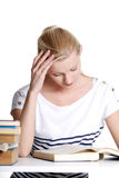 Young student woman with lots of books Royalty Free Stock Photography