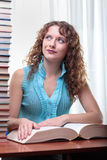 Young student woman with lots of books. Royalty Free Stock Image