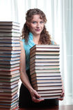 Young student woman with lots of books. Stock Image