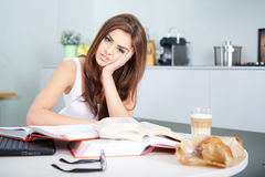 Young student woman with lots of books studying Stock Photo
