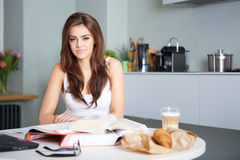 Young student woman with lots of books studying Stock Photography