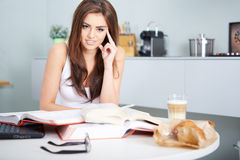 Young student woman with lots of books studying Stock Image