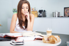 Young student woman with lots of books studying Royalty Free Stock Photos
