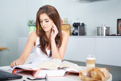 Young student woman with lots of books studying Stock Images