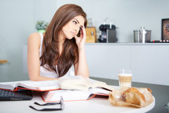 Young student woman with lots of books studying Royalty Free Stock Photo