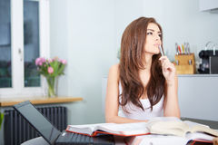 Young student woman with lots of books studying Royalty Free Stock Images