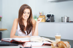 Young student woman with lots of books studying Stock Photos