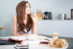 Young student woman with lots of books studying Royalty Free Stock Photography