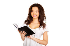Young student woman with notebook. Royalty Free Stock Photography