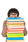 Young student woman peeking from stack of  books, isolated Stock Image