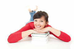 Young student woman resting on the stack of books Royalty Free Stock Images