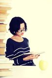 Young student woman studying at the desk Stock Images