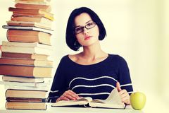 Young student woman studying at the desk Royalty Free Stock Image
