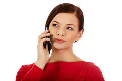 Young student woman talking through a mobile phone Stock Image