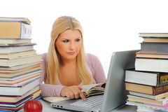Young Student Woman With Lots Of Books And Laptop Stock Photo