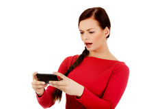 Young student woman yelling to the mobile phone Stock Photo