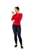 Young student woman yelling to the mobile phone Stock Photography