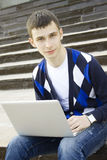 Young student working on a laptop Royalty Free Stock Photos