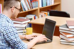 Young student working in a library Royalty Free Stock Photos
