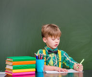 Young student writes in a notebook.  Stock Images