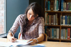 Young student writing Royalty Free Stock Photo