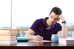 Young student writing Stock Images