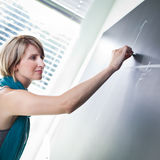 Young  student writing on the blackboard Royalty Free Stock Photography