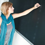 Young  student writing on the blackboard Royalty Free Stock Images