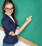 Young student writing on blackboard. Royalty Free Stock Photos